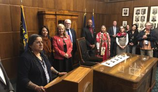 In this May 16, 2019 photo, Patricia Whitefoot, left, a member of the Yakama tribe from White Swan, Washington, poses for a photo after Gov. Kate Brown signed a bill directing the state police to study how to improve criminal justice resources to solve cases of Native American women who have gone missing or been killed. Whitefoot's sister Daisy disappeared in 1987. The case was never solved. Whitefoot was involved in the effort to pass the bill in Oregon, and a similar one in Washington state earlier. (AP Photo/Andrew Selsky)