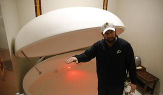 In this April 12, 2019, photo, Washington Redskins head athletic trainer Larry Hess demonstrates a salt water float orb inside a recovery room at the team's NFL football training facility in Ashburn, Va. With the use of state-of-the-art machines and techniques, the Redskins hope to cut down on injuries after leading the NFL in players on injured reserve last season. (AP Photo/Patrick Semansky) **FILE**