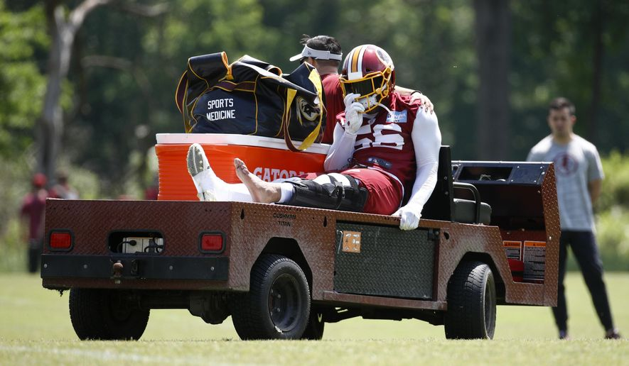 Washington Redskins linebacker Reuben Foster rides a cart off the field after suffering an injury during a practice at the team's NFL football practice facility, Monday, May 20, 2019, in Ashburn, Va. (AP Photo/Patrick Semansky) ** FILE **