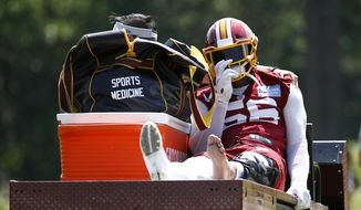 Washington Redskins linebacker Reuben Foster rides a cart off the field after suffering an injury during a practice at the team's NFL football practice facility, Monday, May 20, 2019, in Ashburn, Va. (AP Photo/Patrick Semansky)