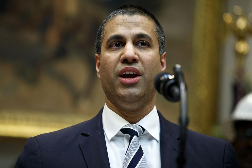 FILE - In this April 12, 2019 file photo, Federal Communications Commission Chairman Ajit Pai speaks during an event with President Donald Trump on the deployment of 5G technology in the United States, in the Roosevelt Room of the White House, in Washington. Pai says he plans to recommend the agency approve the $26.5 billion merger of wireless carriers T-Mobile and Sprint, saying it'll speed up 5G deployment in the U.S. Pai also said Monday, May 20 that the combination will help bring faster mobile broadband to rural Americans. (AP Photo/Evan Vucci, File)