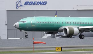 In this April 10, 2019, file photo, a Boeing 737 Max 8 airplane being built for India-based Jet Airways lands following a test flight at Boeing Field in Seattle. Boeing 737 MAX jets will remain grounded until at least mid-August, the International Air Transport Association said on May 29, 2019.  (AP Photo/Ted S. Warren, File)