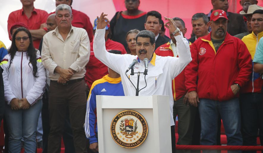 Venezuela's President Nicolas Maduro speaks to supporters outside Miraflores presidential palace in Caracas, Venezuela, Monday, May 20, 2109. Maduro is celebrating the anniversary of his disputed re-election amid a growing humanitarian crisis and political upheaval. (AP Photo/Ariana Cubillos)