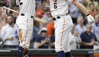 Houston Astros' Jake Marisnick (6) celebrates his solo home run off Chicago White Sox relief pitcher Jace Fry with Alex Bregman during the third inning of a baseball game, Monday, May 20, 2019, in Houston. (AP Photo/Eric Christian Smith)