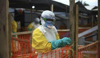 In this Tuesday April, 16, 2019 file photo, an Ebola health worker is seen at a treatment center in Beni, Eastern Congo.  (AP Photo/Al-hadji Kudra Maliro, file) **FILE**