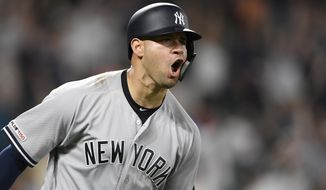 New York Yankees' Gary Sanchez reacts as he heads to first to round the bases after hitting a three-run home run during the ninth inning of a baseball game against the Baltimore Orioles, Monday, May 20, 2019, in Baltimore. (AP Photo/Nick Wass)