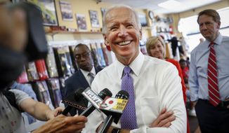 "Former Vice President Joe Biden smiles as he speaks to the media during a campaign stop with Democratic gubernatorial candidate Richard Cordray at the Beyond Image Barber Salon, Friday, June 29, 2018, in Cincinnati. Former Vice President Joe Biden is urging Americans to ""rise up"" to demand President Donald Trump nominate a ""consensus candidate"" to the Supreme Court. Biden sided with Democrats who have said the Senate should postpone the confirmation process until after the mid-term elections. He said, ""so many of our fundamental rights, freedoms, and liberties, and the rule of law, are all at risk.""(AP Photo/John Minchillo)"