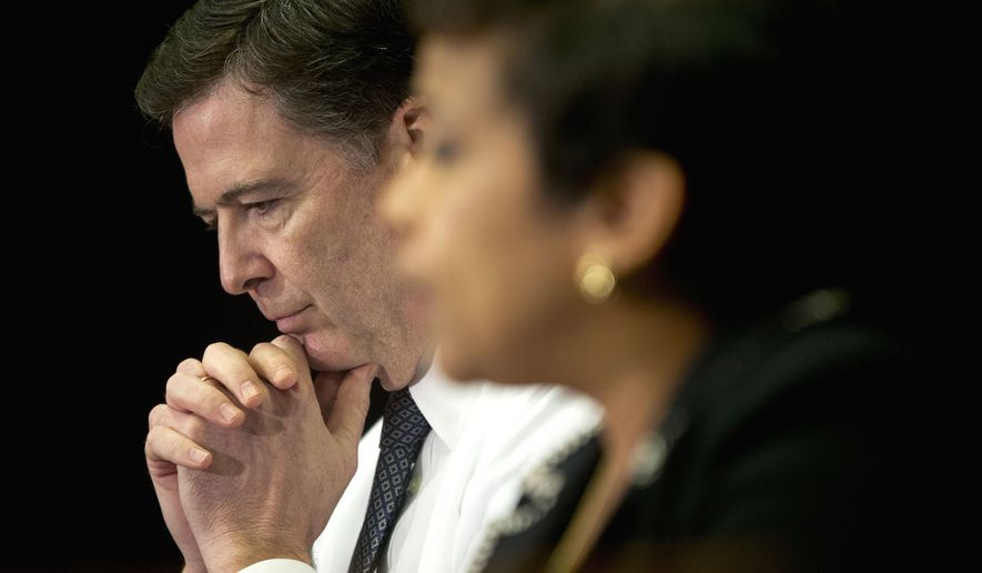 Then-FBI Director James Comey listens at left as Attorney General Loretta Lynch speaks during their sit down meeting with members of the media at Justice Department in Washington, Thursday, Nov. 19, 2015. (AP Photo/Pablo Martinez Monsivais)