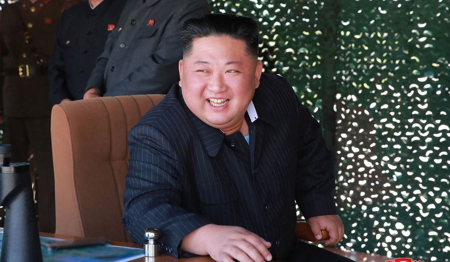 "FILE - This May 9, 2019, file photo provided on May 10, by the North Korean government shows North Korean leader Kim Jong Un, observing a military test in North Korea. North Korea has labeled Joe Biden a ""fool of low IQ"" and an ""imbecile bereft of elementary quality as a human being"" after the Democratic presidential hopeful during a recent speech called North Korean leader Kim Jong Un a tyrant. Independent journalists were not given access to cover the event depicted in this image distributed by the North Korean government. The content of this image is as provided and cannot be independently verified. Korean language watermark on image as provided by source reads: ""KCNA"" which is the abbreviation for Korean Central News Agency. (Korean Central News Agency/Korea News Service via AP, File)"