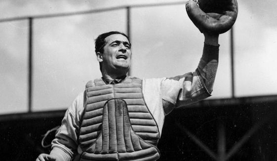 FILE - In this March 29, 1938, file photo, Boston Red Sox' catcher Moe Berg is seen during spring training in Sarasota, Fla. Berg was a big league catcher who became a big time spy during World War II. Filmmaker Aviva Kempner tells her story in a new documentary, and tells PodcastOne Sports Now that he was a mysterious character throughout his life. Kempner joins co-hosts Jim Litke and Tim Dahlberg to talk about the remarkable story of the catcher, who played 15 years in the major leagues, the last five with the Boston Red Sox before his career ended in 1939.(AP Photo/File)