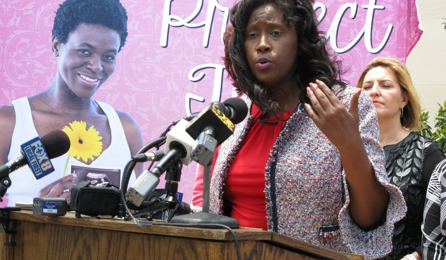 Rep. Katrina Jackson, D-Monroe, talks to reporters about her bill asking voters to add language into the state constitution declaring that it doesn't protect abortion rights, on Tuesday, May 21, 2019, in Baton Rouge, La. The bill is nearing final legislative passage. (AP Photo/Melinda Deslatte)