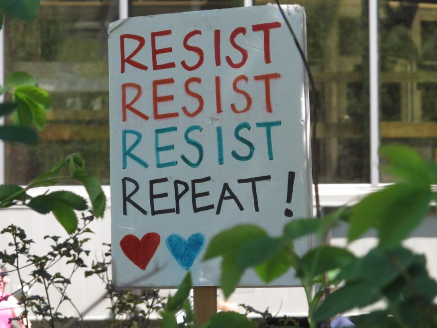 This sign was among those dotting a gathering of abortion rights advocates in Juneau, Alaska on Tuesday, May 21, 2019. Several states have taken steps to ban or severely restrict abortions, and a bill was introduced in the Alaska House that seeks to outlaw abortion. (AP Photo/Becky Bohrer)