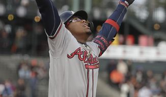 Atlanta Braves' Ronald Acuna Jr. celebrates after hitting a solo home run against the San Francisco Giants during the first inning of a baseball game in San Francisco, Monday, May 20, 2019. (AP Photo/Jeff Chiu)