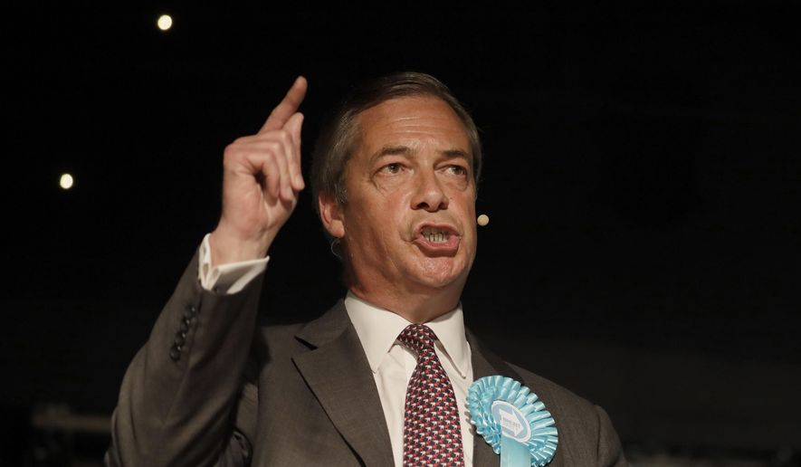 British Politician Nigel Farage speaks on stage during a Brexit Party rally at Lakeside Country Club in Frimley Green in Surrey, England, Sunday, May 19, 2019. (AP Photo/Kirsty Wigglesworth)