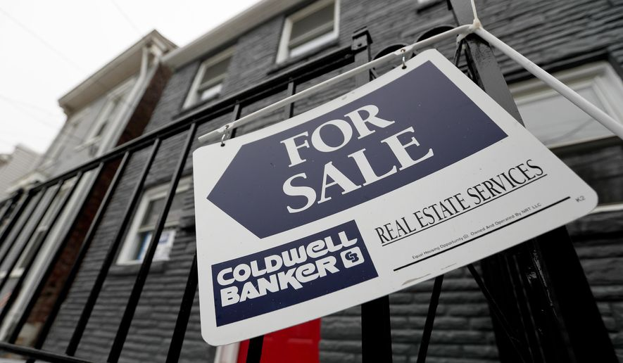 FILE- In this Jan. 4, 2019, file photo a sign hangs outside a house for sale in Pittsburgh's Lawrenceville neighborhood. U.S. home sales slipped 0.4% in April 2019, as would-be homebuyers face affordability challenges and a limited supply of starter houses.  The National Association of Realtors says that existing homes sold at a seasonally adjusted annual rate of 5.19 million last month, down from 5.21 million in March 2019. (AP Photo/Keith Srakocic, File)