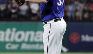 Texas Rangers starting pitcher Lance Lynn jumps off the mound after giving up an RBI single to Seattle Mariners' Omar Narvaez during the seventh inning of a baseball game in Arlington, Texas, Tuesday, May 21, 2019. (AP Photo/Tony Gutierrez)