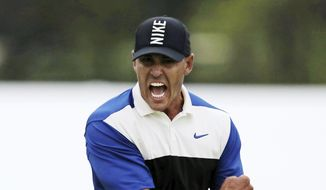 Brooks Koepka reacts after sinking a putt on the 18th green to win the PGA Championship golf tournament, Sunday, May 19, 2019, at Bethpage Black in Farmingdale, N.Y. (AP Photo/Charles Krupa) **FILE**