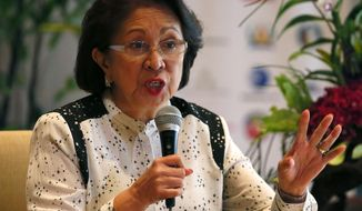 FILE - In this Aug. 27, 2016, file photo, Philippine Ombudsman Conchita Carpio-Morales, one of the Ramon Magsaysay awardees for this year, stresses a point during a news conference in Manila, Philippines. Carpio- Morales, who accused Chinese President Xi Jinping of crimes against humanity before the International Criminal Court, says she has been barred for hours from entering Hong Kong for unspecified reasons. (AP Photo/Bullit Marquez, File)