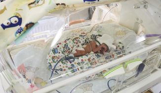 Incubators with one of the sextuplets, believed to be Poland's first ever and said to be doing fine, that have all been placed in incubators to assist their development at the University Hospital in Krakow, Poland, on Tuesday, 21 May 2019. The babies were born Monday in the 29th week of pregnancy through caesarean section.(AP Photo/Beata Zawrzel) Poland Out