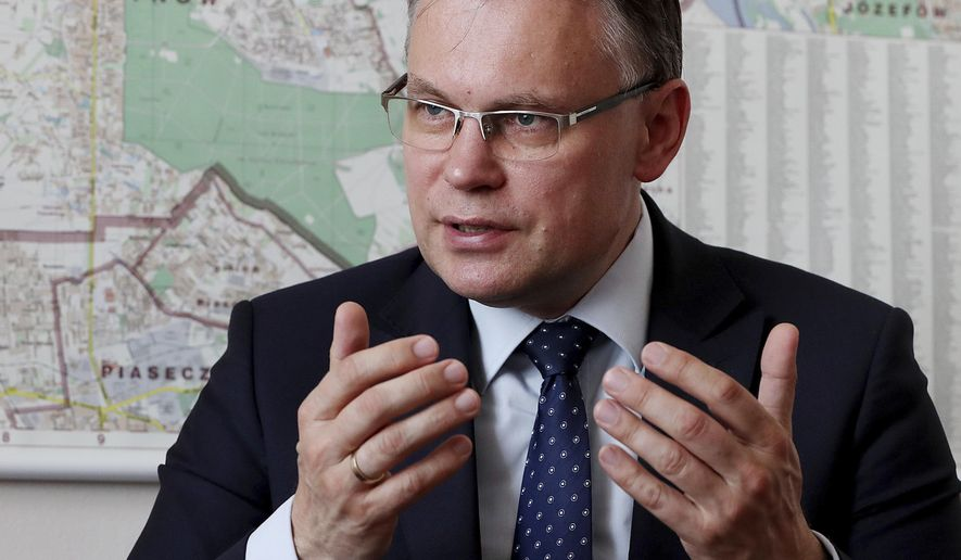 Poland's ruling party lawmaker Arkadiusz Mularczyk talks to The Associated Press in the parliament building in Warsaw, Poland, on Tuesday, May 21, 2019, about a report that assesses Poland's World War II losses and that, he says, will be given to German government. Contrary to Germany claims, Mularczyk says there are no documents or records suggesting that Poles has ever renounced its right to seek reparations from Berlin.(AP Photo/Czarek Sokolowski)