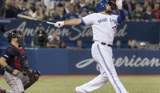 Toronto Blue Jays' Rowdy Tellez watches his three-run home run against the Boston Red Sox during the fifth inning of a baseball game Tuesday, May 21, 2019, in Toronto. It was Tellez's second homer of the night.  (Fred Thornhill/The Canadian Press via AP)