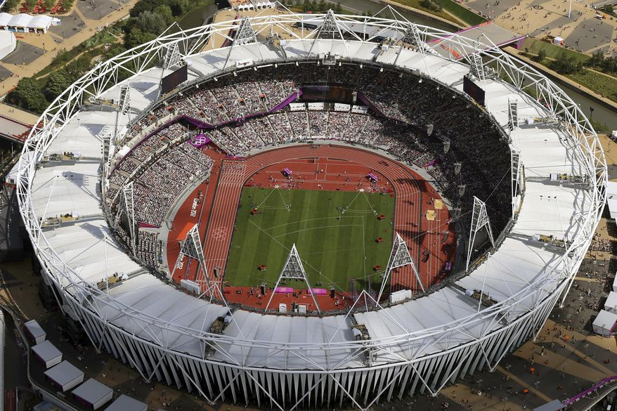 FILE - In this Aug. 3, 2012, file photo, Olympic Stadium is viewed during the Summer Olympics at Olympic Park in London. The traditional rivalry New York Yankees and the Boston Red Sox will take a radical twist when they meet in London next month: They will play on artificial turf for the first time in more than 2,200 games over a century. Major League Baseball has access to Olympic Stadium for 21 days before the games on June 29 and 30, the sport's first regular-season contests in Europe, and just five days after to clear out. (AP Photo/Jeff J Mitchell, Pool, File)