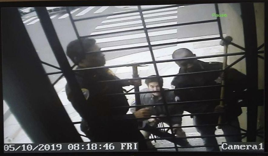 In this May 10, 2019, image from video provided by Bryan Carmody San Francisco police armed with sledgehammers execute a search warrant at journalist Bryan Carmody's home in San Francisco. The San Francisco reporter is seeking the return of property after police raided his home, as officials sought to determine the source of a leaked police report into the death of the city's public defender. An attorney for Carmody will make the request Tuesday, May 21 in San Francisco County Superior Court. (Bryan Carmody/@bryancarmody via AP)