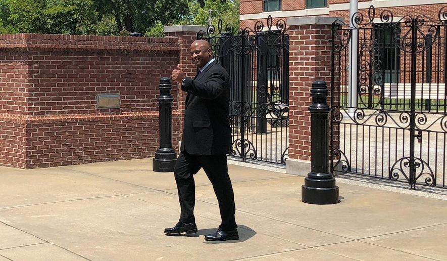 Suspended Chester County Sheriff Alex Underwood gives a thumbs-up as he walks out of the federal courthouse in Columbia, South Carolina, on Tuesday, May 21, 2019. Prosecutors said Underwood jailed an innocent man then created a false police report to cover his tracks and lied to the FBI. (AP Photo/Jeffrey Collins)