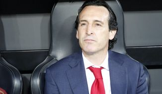 Arsenal manager Unai Emery looks from the bench prior to the Europa League semifinal soccer match, second leg, between Valencia and Arsenal at the Camp de Mestalla stadium in Valencia, Spain, Thursday, May 9, 2019. (AP Photo/Alberto Saiz)