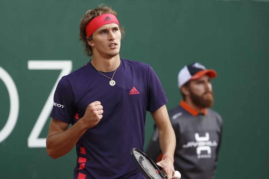 Alexander Zverev of Germany celebrates defeating Ernests Gulbis of Latvia during their second round match at the ATP 250 Geneva Open tournament in Geneva, Switzerland, Tuesday, May 21, 2019. (Salvatore Di Nolfi/Keystone via AP)