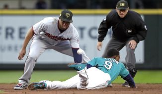The ball pops away from Minnesota Twins second baseman Jonathan Schoop, left, as Seattle Mariners' Dee Gordon steals second base during the third inning of a baseball game Friday, May 17, 2019, in Seattle. (AP Photo/Elaine Thompson)