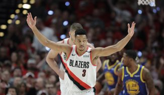 Portland Trail Blazers guard CJ McCollum (3) reacts after a play against the Golden State Warriors during the first half of Game 4 of the NBA basketball playoffs Western Conference finals, Monday, May 20, 2019, in Portland, Ore. (AP Photo/Ted S. Warren)