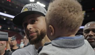 Golden State Warriors guard Stephen Curry holds his son Canon as he walks off the court after Game 4 of the NBA basketball playoffs Western Conference finals against the Portland Trail Blazers, Monday, May 20, 2019, in Portland, Ore. The Warriors won 119-117 in overtime. (AP Photo/Ted S. Warren) **FILE**
