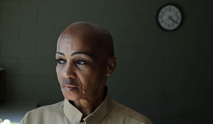 "In this May 9, 2019 photo, Cheryl Lidel poses for a photo in the Washington Correctional Center in Shelton, Wash. Lidel is among a small group of inmates who are set to stay in Washington state prisons for life who were left out of the latest in a multi-year wave of reforms easing tough-on-crime ""three strikes"" laws around the U.S. (AP Photo/Ted S. Warren)"