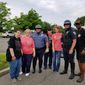 Bob Rivers (right) stands with Gold Star Daughters and Arlington County Police Department officers who provided motorcycle escort in 2018. (Photo courtesy of Bob Rivers.)