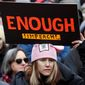 A woman holds a sign expressing her opinion about impeaching President Donald Trump at a rally organized by Women's March NYC at Foley Square in Lower Manhattan, Saturday, Jan. 19, 2019, in New York. (AP Photo/Kathy Willens)