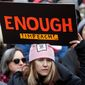 A woman holds a sign expressing her opinion about impeaching President Donald Trump at a rally organized by Women's March NYC at Foley Square in Lower Manhattan, Saturday, Jan. 19, 2019, in New York. (AP Photo/Kathy Willens) ** FILE **