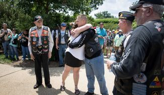 Legionnaire Charles Webb hugs Gold Star Mother Barbara Bilbrey, center, while World War II veteran Bruce Heilman, and Phil Perlman, left and right, join Legion members to lay a wreath at the Civil War Unknown Monument during the American Legion Riders Run To The Thunder in Washington, D.C., on Saturday, May 26, 2018. (Photo by Cheryl Diaz Meyer / The American Legion)