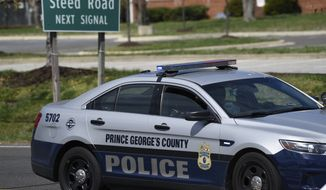 A Prince George's County, Md. Police vehicle is seen near the location where a military aircraft crashed, Wednesday, April 5, 2017, in Clinton, Md. Air Force officials said in a statement Wednesday that the D.C. Air National Guard F-16C crashed in southwest of Joint Base Andrews. Officials say the pilot ejected and is safe. (AP Photo/Sait Serkan Gurbuz)