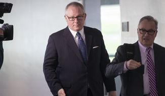 Former Donald Trump campaign official Michael Caputo, left, joined by his attorney Dennis C. Vacco, leaves after being interviewed by Senate Intelligence Committee staff investigating Russian meddling in the 2016 presidential election, on Capitol Hill in Washington, Tuesday, May 1, 2018. Caputo had previously appeared before the House Intelligence Committee as it was investigating election interference by Russia. (AP Photo/J. Scott Applewhite)