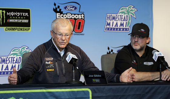 Joe Gibbs, owner of Joe Gibbs Racing, left, speaks during a news conference for the NASCAR Cup series auto race at the Homestead-Miami Speedway, Friday, Nov. 16, 2018, in Homestead, Fla. At right is Tony Stewart, owner of Stewart-Haas Racing. (AP Photo/Terry Renna) **FILE**