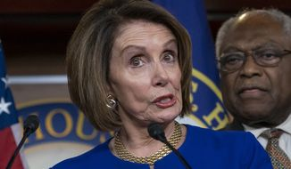 "Speaker of the House Nancy Pelosi, D-Calif., joined at right by Majority Whip James E. Clyburn, D-S.C., and other congressional leaders, reacts to a failed meeting with President Donald Trump at the White House on infrastructure, at the Capitol in Washington, Wednesday, May 22, 2019. Trump lashed out at Pelosi after she told reporters earlier in the morning on Capitol Hill she believed the president engaged in a ""cover up"" of the Russia probe. (AP Photo/J. Scott Applewhite)"