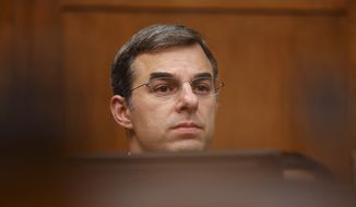 "House Oversight and Reform National Security subcommittee member Rep. Justin Amash, R-Mich., looks out from the dais on Capitol Hill in Washington, Wednesday, May 22, 2019, during the House Oversight and Reform National Security subcommittee hearing on ""Securing U.S. Election Infrastructure and Protecting Political Discourse."" (AP Photo/Carolyn Kaster)"