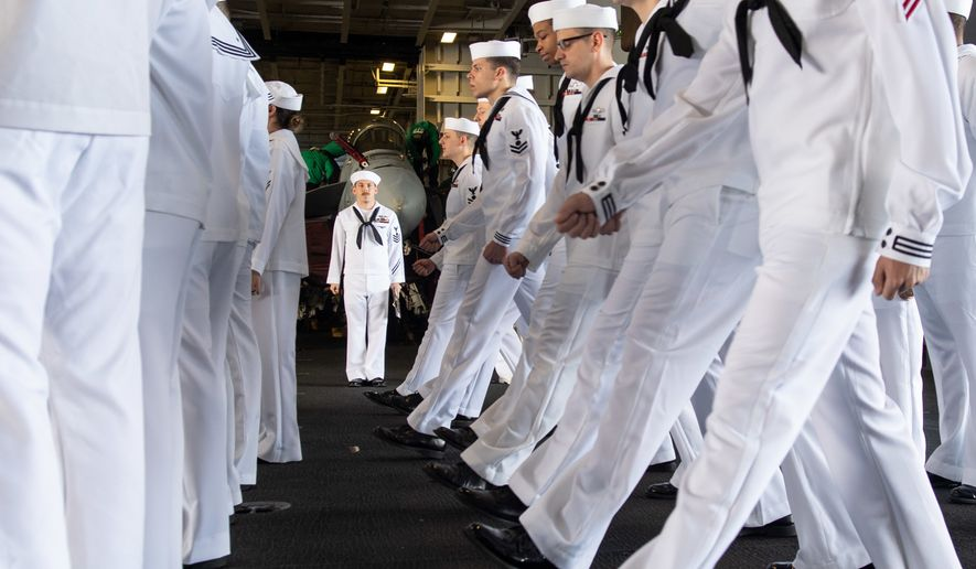 U.S. Navy Electricians Mate 1st Class Michael Feola, center, from Chatanooga, Tennessee, orders Sailors to march forward during a dress white uniform inspection in the hangar bay aboard the aircraft carrier USS John C. Stennis (CVN 74) in the Atlantic Ocean, May 10, 2019. The John C. Stennis is operating in the U.S. 2nd Fleet in support of naval operations to maintain maritime stability and security in the Atlantic and Arctic in order to ensure access, deter aggression and defend U.S., allied and partner interests. (U.S. Navy photo by Mass Communication Specialist Seaman Jarrod A. Schad)