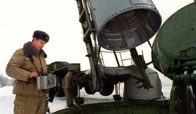A SS-19 strategic missile warhead is loaded into a silo at a site near Saratov, 563 miles south of Russia. (AP Photo/Str)