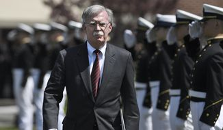 National Security Adviser John Bolton is saluted as he arrives to speak at the commencement for the United States Coast Guard Academy in New London, Conn., Wednesday, May 22, 2019. (AP Photo/Jessica Hill)