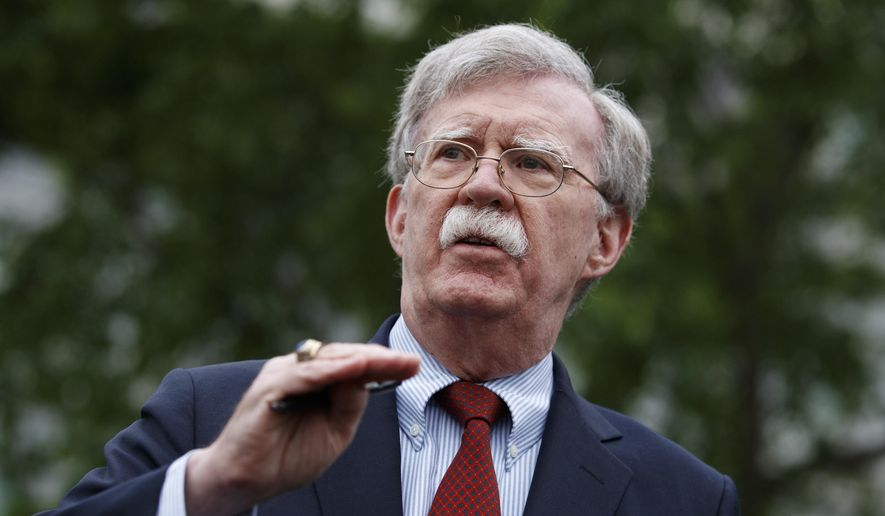 In this Wednesday, May 1, 2019, file photo, National Security Adviser John Bolton talks to reporters about Venezuela, outside the White House, in Washington. (AP Photo/Evan Vucci, File)