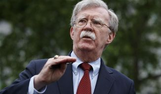 FILE - In this Wednesday, May 1, 2019 file photo, National Security Adviser John Bolton talks to reporters about Venezuela, outside the White House, in Washington. Bolton is scheduled to deliver the keynote address Wednesday, May 22, 2019, at the United States Coast Guard Academy graduation ceremony. Bolton has been President Donald Trump's national security adviser since April of last year. (AP Photo/Evan Vucci, File)