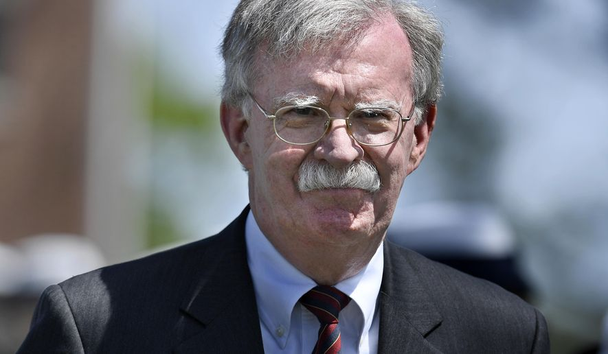 John Bolton arrives to speak at the commencement for the United States Coast Guard Academy in New London, Conn., Wednesday, May 22, 2019. (AP Photo/Jessica Hill)