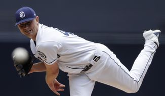 San Diego Padres starting pitcher Eric Lauer works against an Arizona Diamondbacks batter during the first inning of a baseball game Wednesday, May 22, 2019, in San Diego. (AP Photo/Gregory Bull)